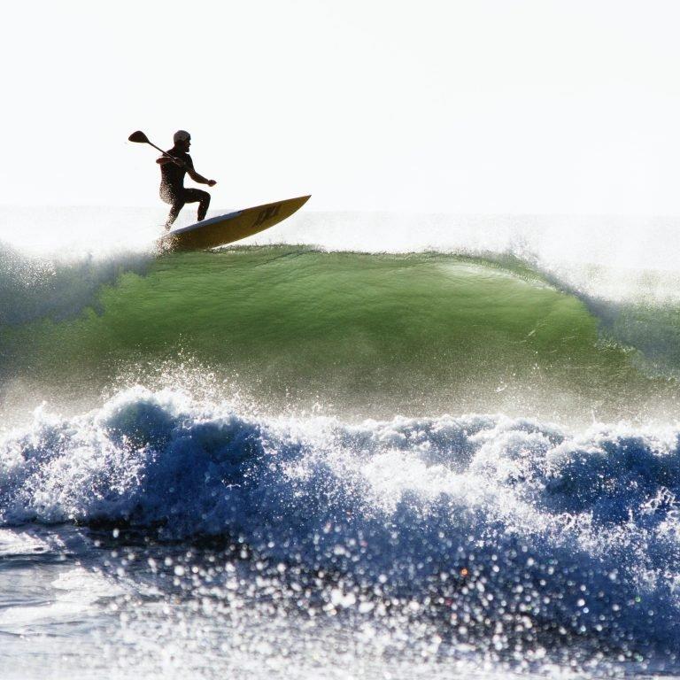 man surfing alone on sea